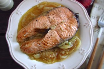 Salmon with onions on a plate