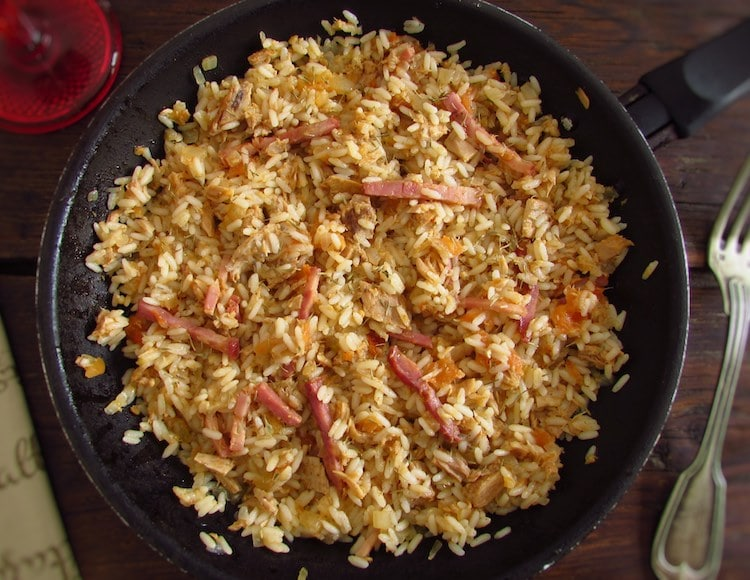 Tuna and bacon with rice on a frying pan