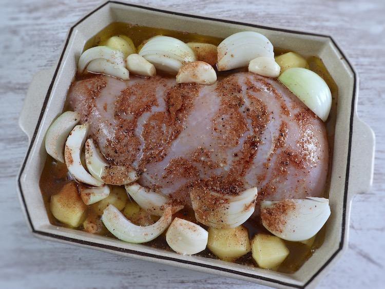 Turkey loin with lemon and cinnamon on a baking dish