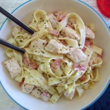 Fried chicken breast with bacon and tagliatelle on a dish bowl