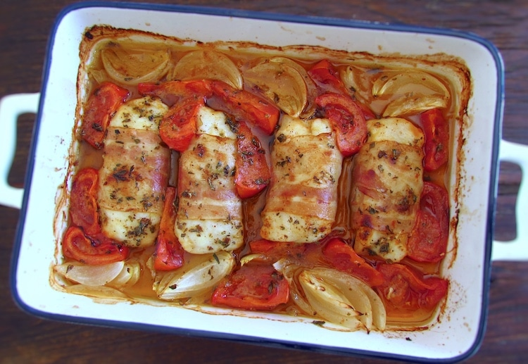 Hake loins with bacon on a baking dish