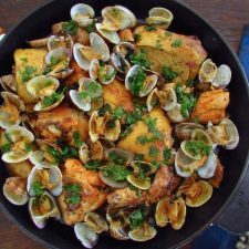 Fried chicken with clams on a frying pan