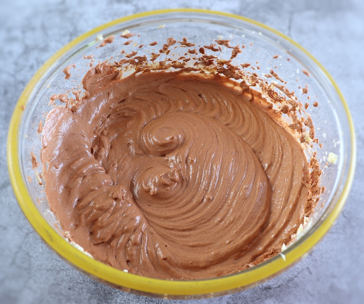 Dough of cocoa lemon cake on a large glass bowl