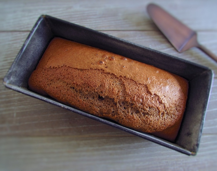 Orange and cinnamon cake on a loaf tin