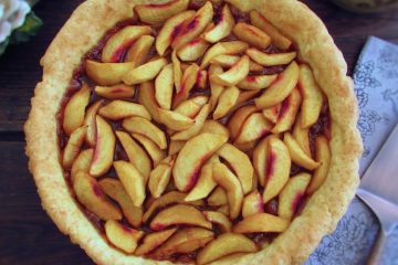 Peach pie on a plate