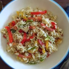 Rice with bacon and peppers on a dish