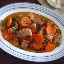 Stewed pork with carrot on a platter