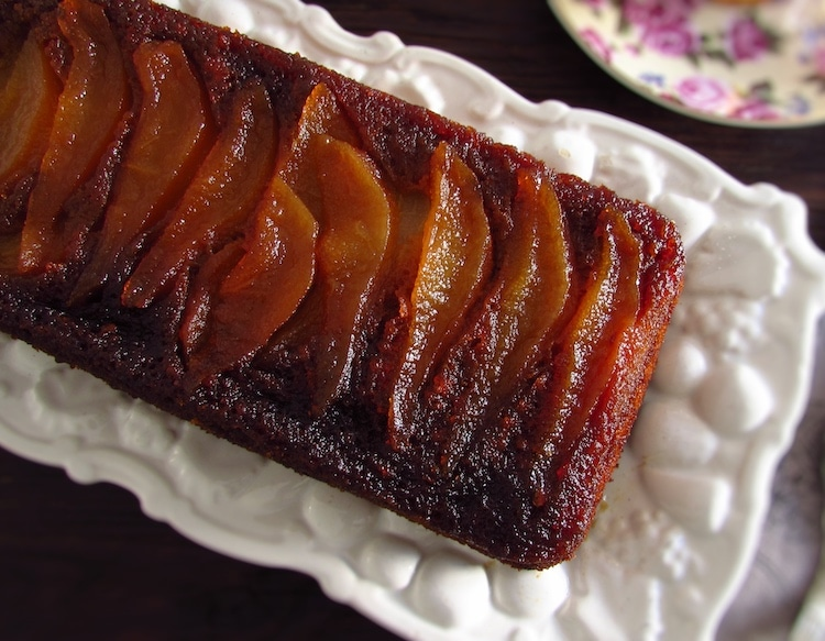 Banana cake with caramelized pear on a platter