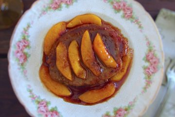 Beef medallions with caramelized peach on a plate