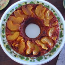 Cinnamon cake with caramelized apple on a plate