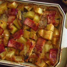Cod in the oven with bacon and honey on a baking dish