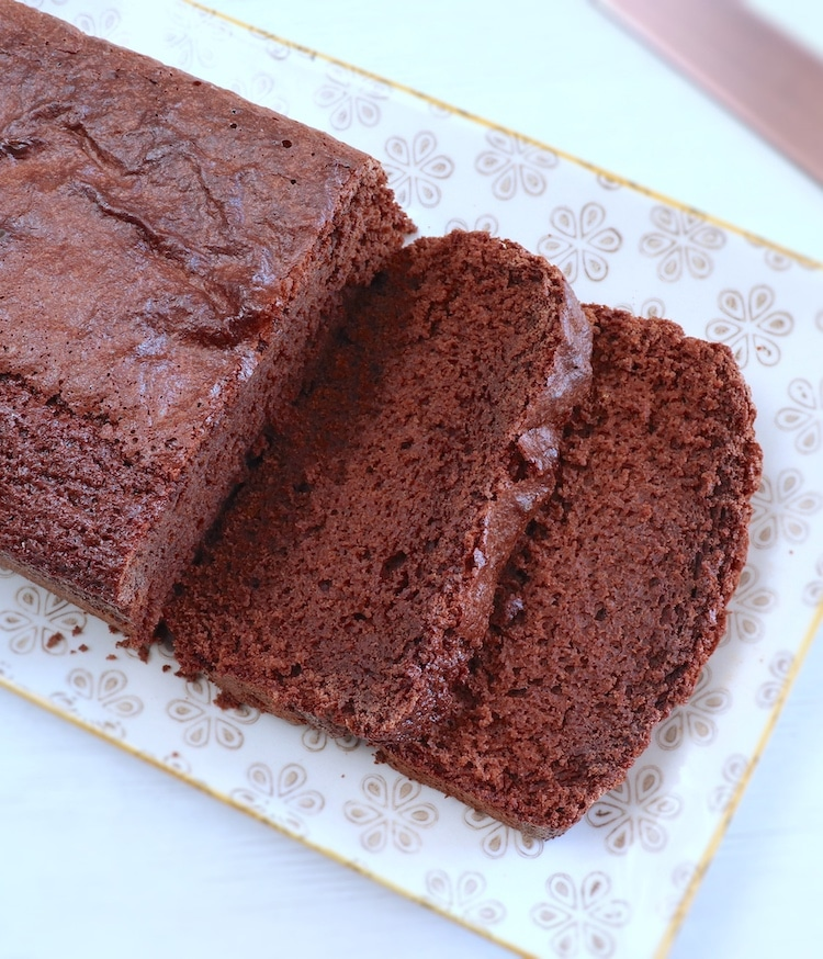 Simple chocolate cake on a rectangular platter