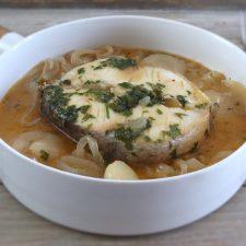Simple stewed hake on a dish bowl