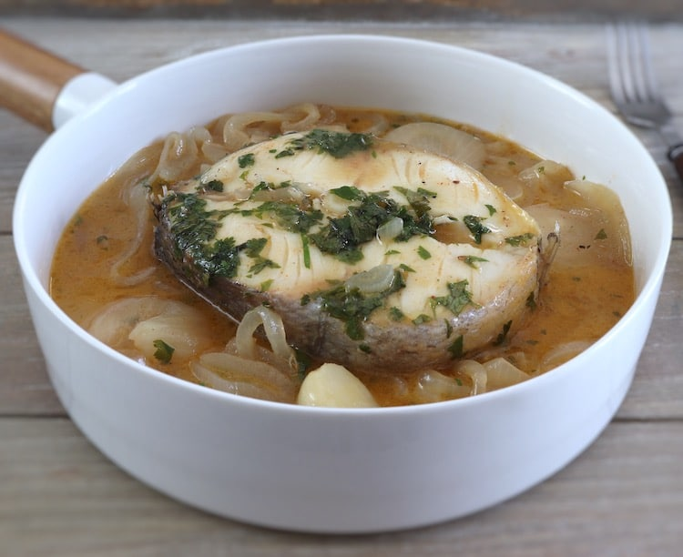 Simple stewed hake on a dish bowl