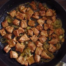 Turkey steaks with lemon, honey and cinnamon on a frying pan
