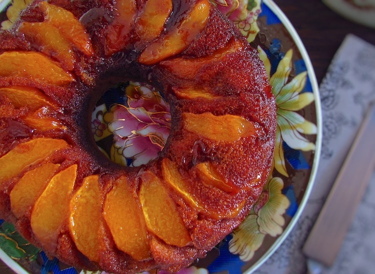 Coffee cake with caramelized peach on a plate