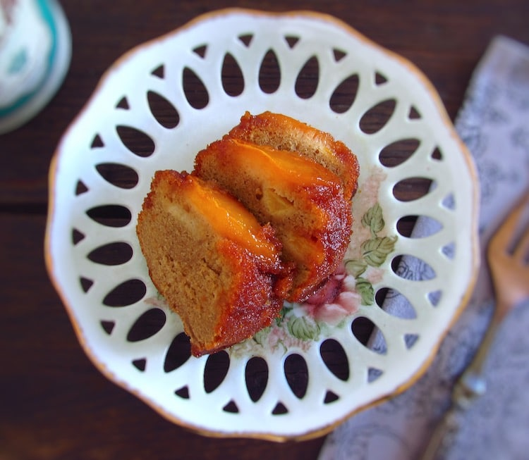Slices of coffee cake with caramelized peach on a plate