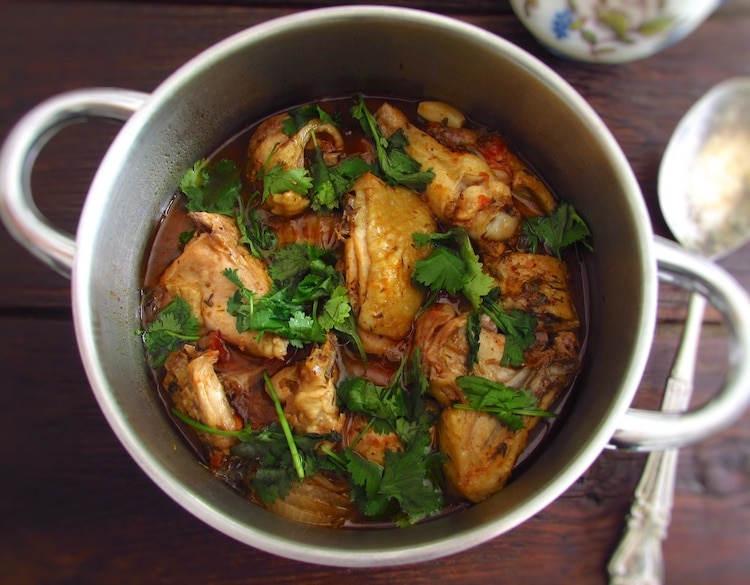 Stewed chicken with spices on a saucepan