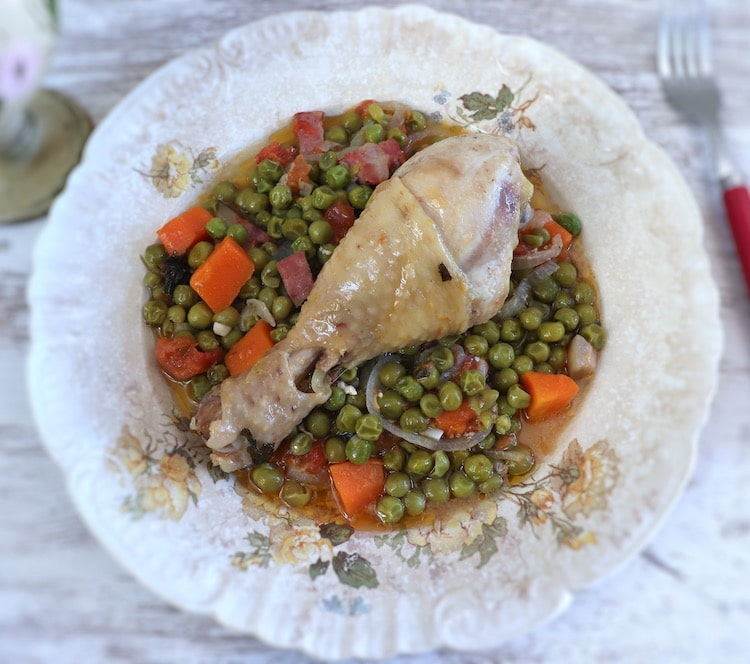 Chicken stew with peas and carrot on a plate