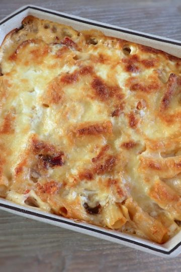 Baked pasta with tuna and ham on a baking dish