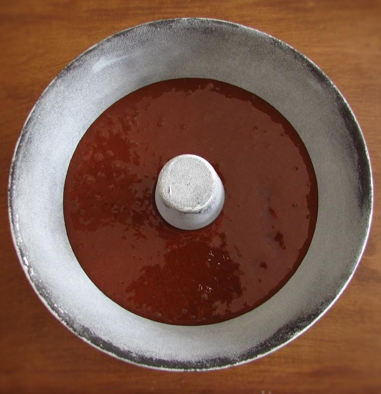 Cocoa cake dough on a bundt cake pan