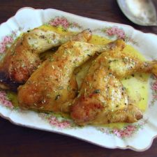 Chicken legs in the oven with mustard on a baking dish
