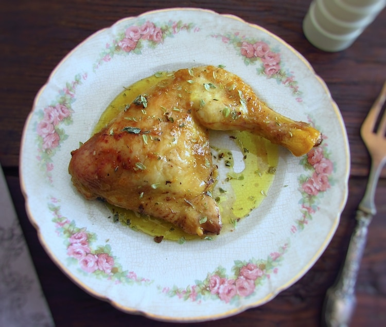 Chicken leg in the oven with mustard on a plate