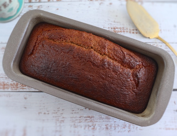 Lemon oregano cake on a loaf tin