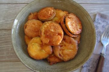 Fried courgette on a plate with a fork