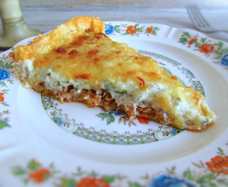 Slice of tuna and chouriço pie on a plate
