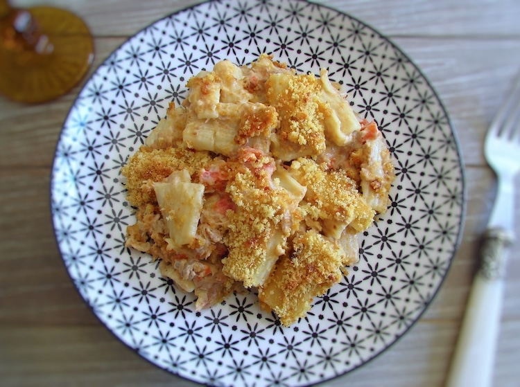 Tuna with pasta and Portuguese cornbread in the oven on a plate with a fork