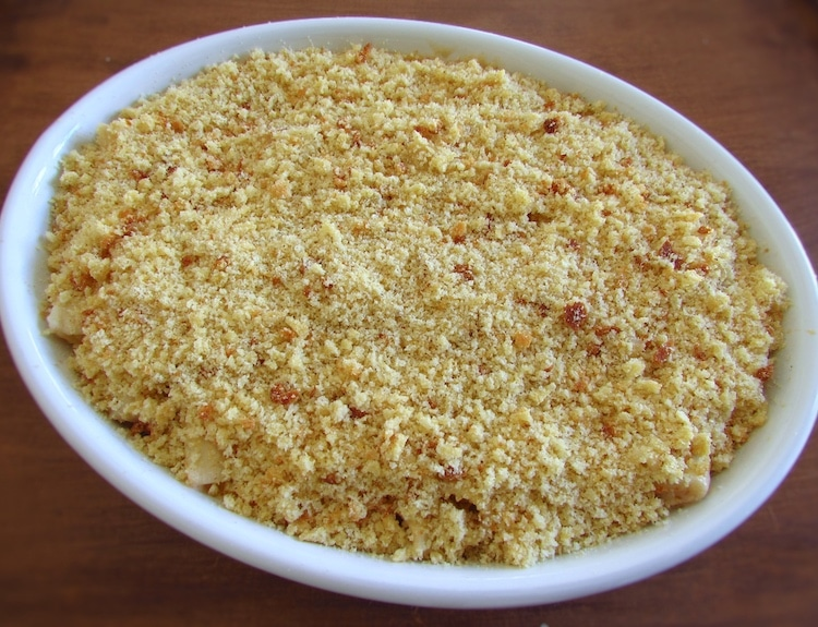 Tuna and pasta mixture on a baking dish and sprinkle with the Portuguese cornbread