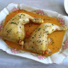 Stewed chicken legs with spices on a platter