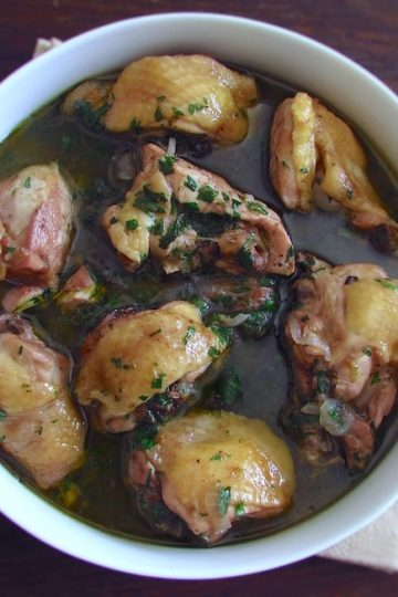 Stewed chicken with red wine on a dish