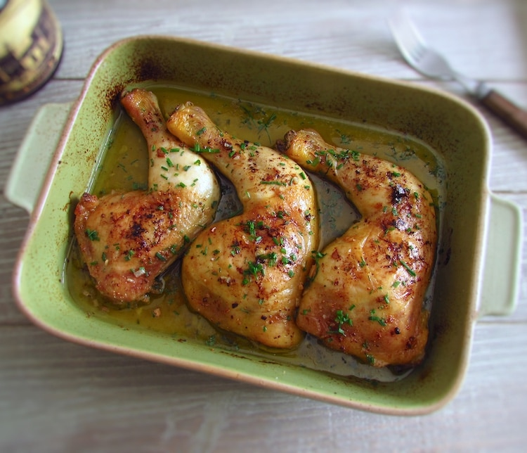 Roasted chicken legs on a baking dish