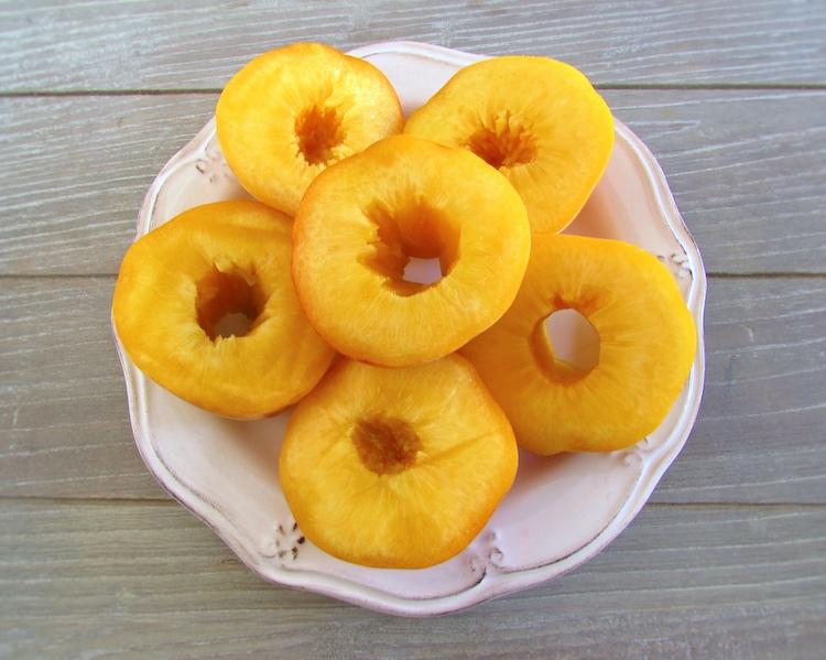 Peach halves on a plate