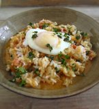 Cod rice with poached eggs