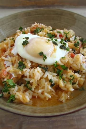Cod rice with poached eggs on a dish bowl