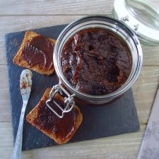 Quince and brown sugar jam on a glass jar with toasts