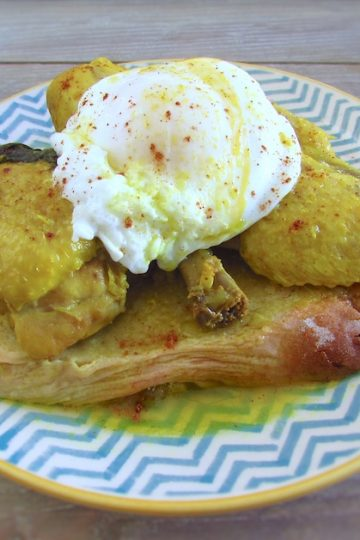 Stewed chicken with poached eggs on a plate