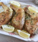 Chicken legs in the oven with garlic and lemon