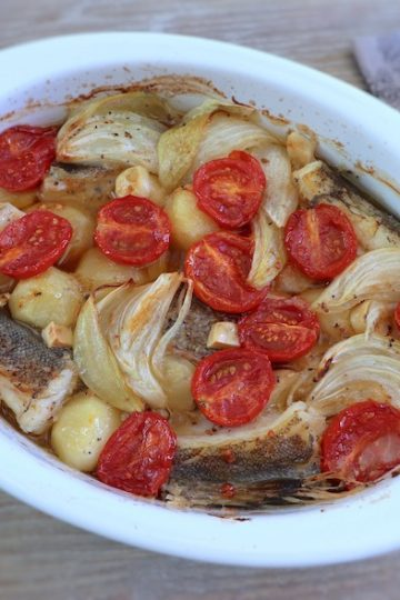 Cod with potatoes in the oven on a baking dish
