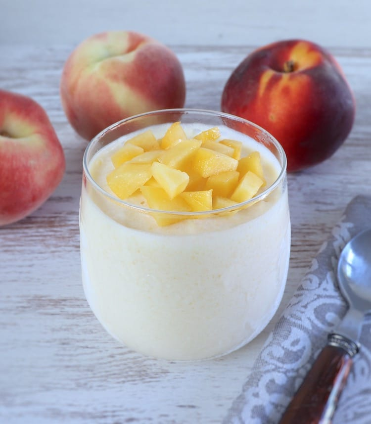 Peach ice cream on a glass bowl