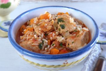 Pork stew with rice and carrot on a tureen