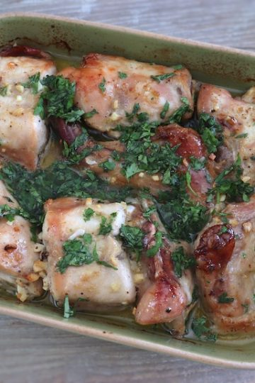 Rabbit in the oven with homemade sauce on a baking dish