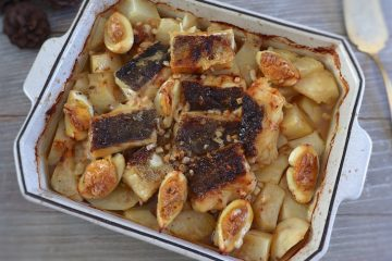 Cod in the oven with potatoes and egg on a baking dish