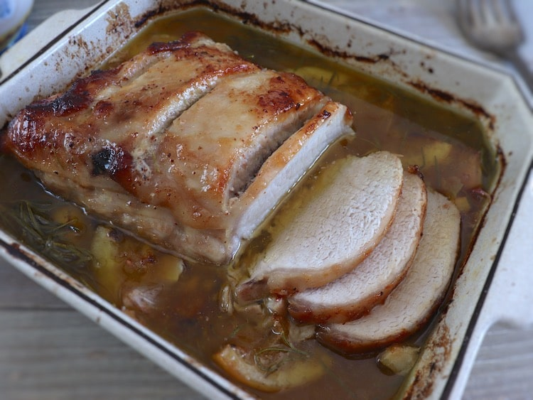Roasted pork loin with lemon and rosemary on a baking dish