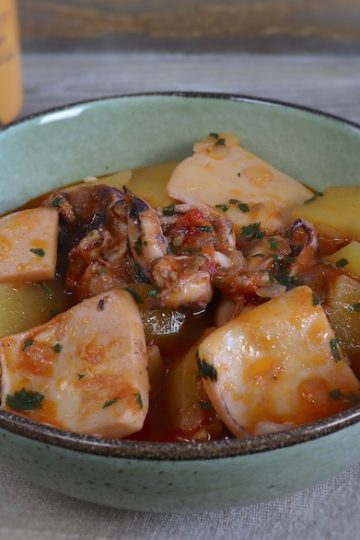Cuttlefish stew with potatoes on a dish bowl
