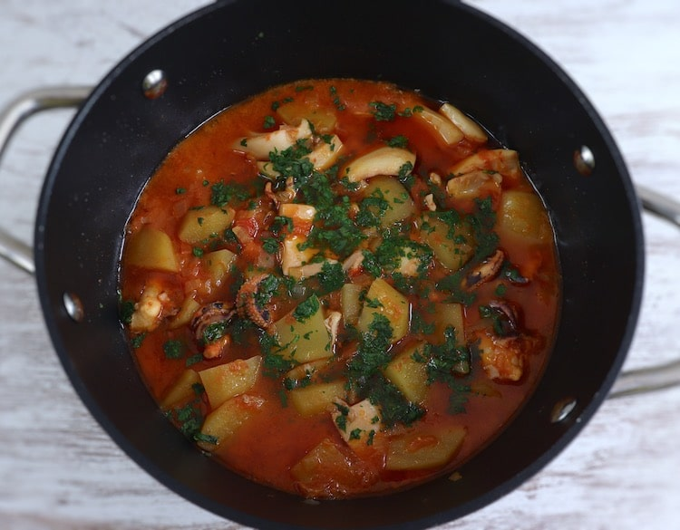 Cuttlefish stew with potatoes on a saucepan