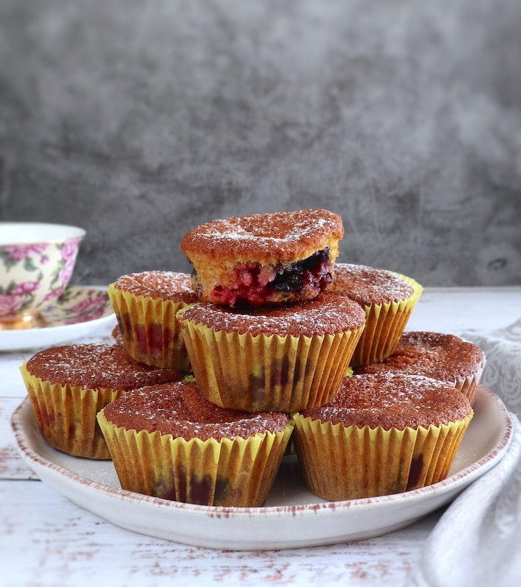 Orange triple berry muffins on a plate